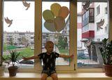 окна семьи Попугаева Савелия