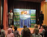 Boris Kudrayvtsev and his puppet theatre getting ready to perform for the kids